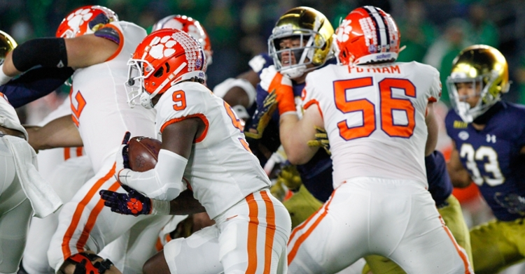 Etienne looks for yardage against Notre Dame as Putnam blocks. (Photo courtesy ACC)