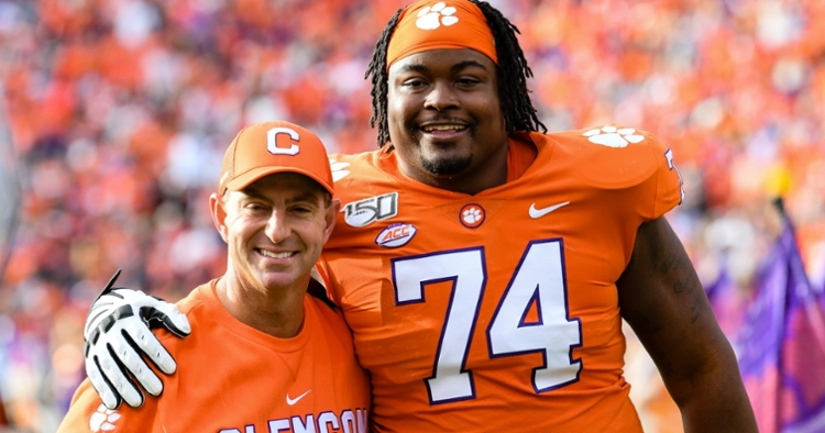 Simpson poses with Swinney before the game against Wake Forest.