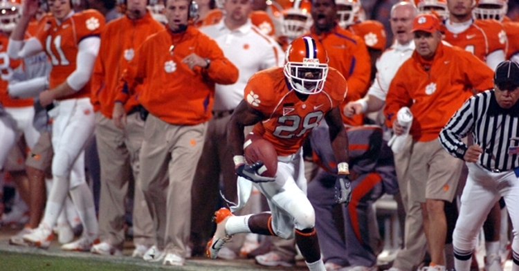 Swinney is in the background of this picture from that 2007 game, intensity for all to see.