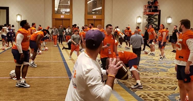 Clemson head coach Dabo Swinney throws a pass in the ballroom Saturday