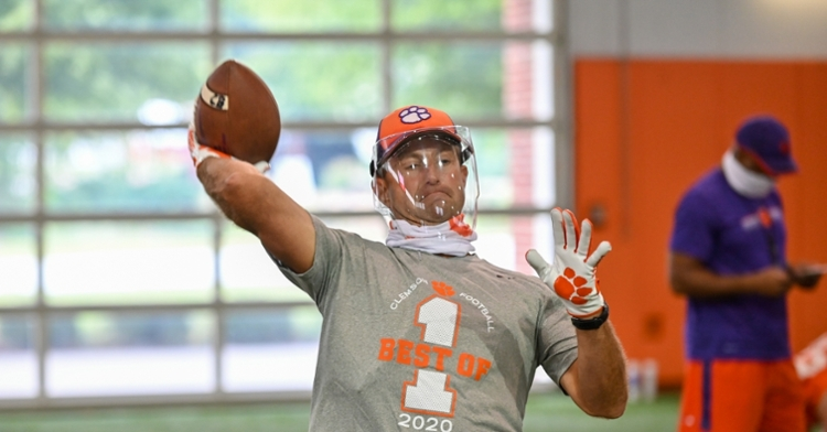 Swinney throws with a face shield before the start of practice. (Photo courtesy of CU Athletics)