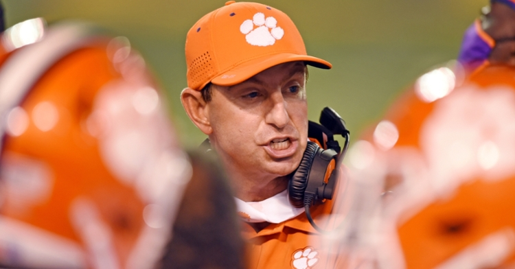 Swinney talks to his players on the sidelines Saturday night at Wake, (Photo per ACC)