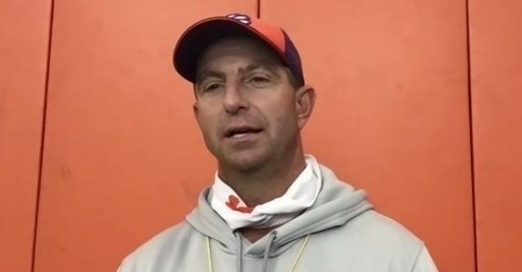 Swinney talks to the media Wednesday after practice