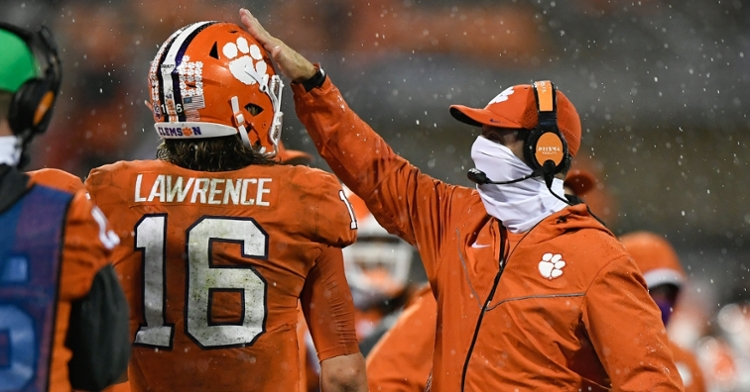 Swinney pats Lawrence on the helmet after a touchdown Saturday. (Photo courtesy ACC)