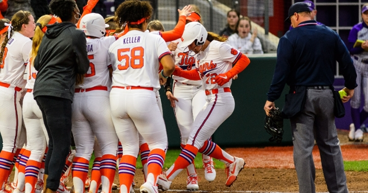 Cagle is greeted at home plate after her homer