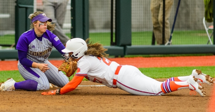 A Clemson runner is tagged out at third (Photo by David Grooms)