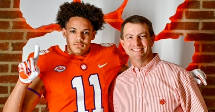 Barnes is shown here with Clemson head coach Dabo Swinney.