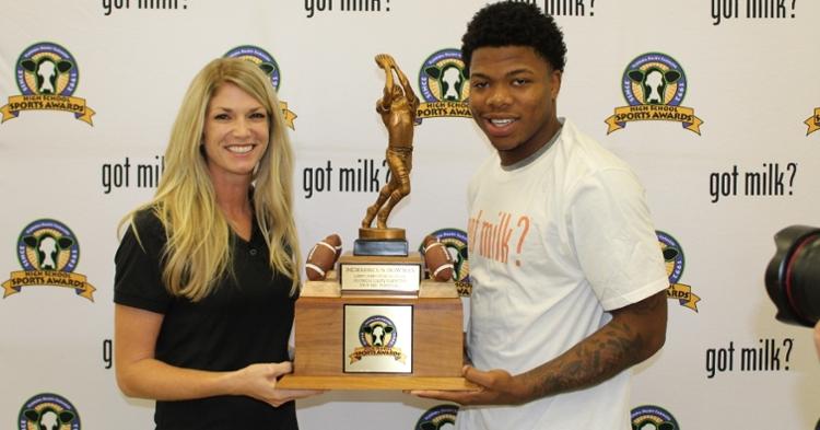 Florida Dairy Farmers representative Brittney Thurlow with 2019 Florida Mr. Football Demarkcus Bowman