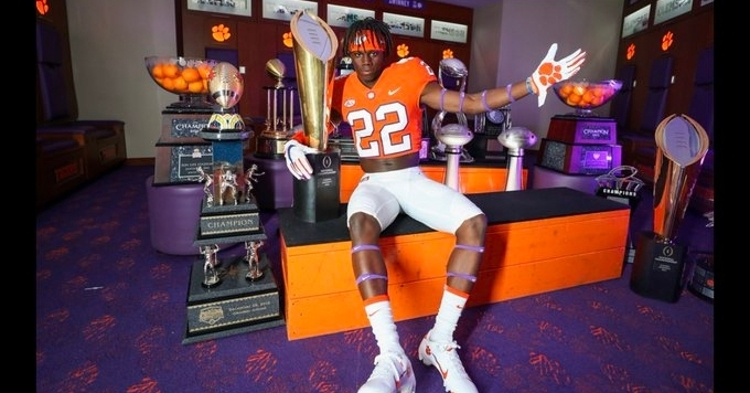 Rucker poses in front of Clemson's impressive array of trophies.