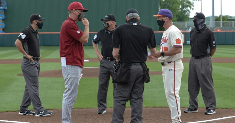 The two coaches meet at home plate before Tuesday's game. (Photo by Ken Ruinard)