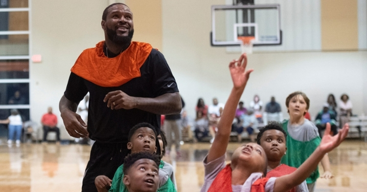 Booker helping our his community at a youth basketball camp (Sabrina Schaeffer - USA Today Sports)