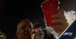 LOOK: Dave Doeren celebrates beating Clemson by smoking cigar on television
