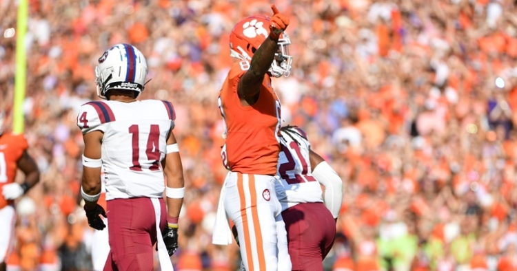 Justyn Ross points after a first down Saturday.