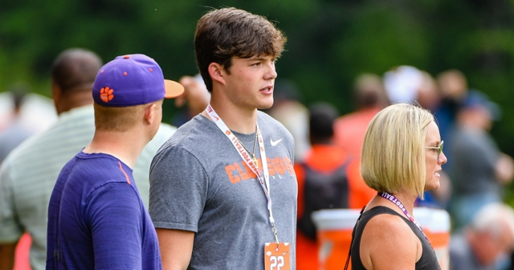 Delp talks with Clemson staffer Thursday during camp.