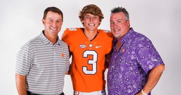Gunn poses with his father (right) and head coach Dabo Swinney (left).