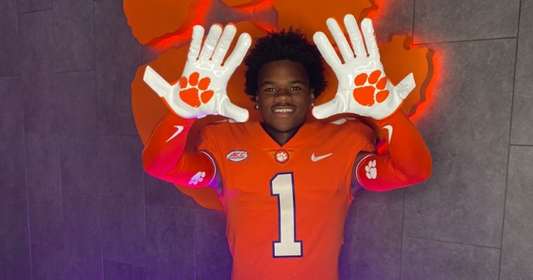 Nation shows off Clemson gloves during his visit.